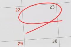 Nadruk op nummer 23 in kalender en lege rode ellips royalty-vrije stock foto