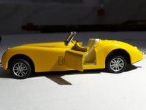 nadużywający jako chłopiec samochodowy fotografa zabawki rocznik Zdjęcia Royalty Free