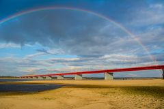 Nadym bridge and rainbow royalty free stock photo