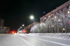 NADYM, RUSSIA - FEBRUARY 25, 2013: New Year - a holiday. Festive street decorations. Beautifully illuminated building and trees. Far north, Nadym Stock Image