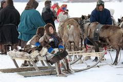 Indigenous people of Northern Siberia on a winter day in the Yam. NADYM, RUSSIA - MARCH 04, 2018: The family of Nenets reindeer herders winter afternoon next to stock photos