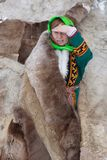 A woman native of the North near the fur tent on the Yamal Penin royalty free stock images