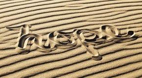 Nadzieja Pisać w Pluskoczącym piasku przy Wielkim piasek diun obywatela Pa Obrazy Stock