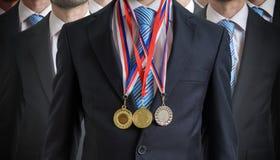 Nadzwyczajny pomyślny pracownik nagradzał dla jego znakomitych umiejętności zdjęcie royalty free