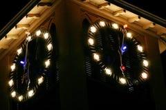 Nadzwyczajny zegar przy nocą Fotografia Stock