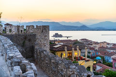 Nafplio City. View on old coastal Nafplio town during summer tourist season at dusk in Peloponnese, Greece stock images