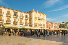 Nafplio, Greece 27 December 2015. People enjoying their free time at Syntagma square in Nafplio Greece. Royalty Free Stock Images