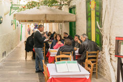 Nafplio, Greece 27 December 2015. Traditional tavern at Nafplio in Greece with people having their lunch. Stock Photography