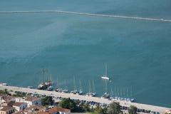 Nafplio seaside marina full with sailboats. Sailboats parked at the Naflpio`s bay marina. Peloponnese, Greece, Europe stock photography