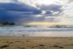 Nag's Head Beach in the morning with surfers Stock Images