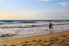 Nag's Head NC USA - August 2016. Nag's Head Beach in the morning with surfers Stock Photo