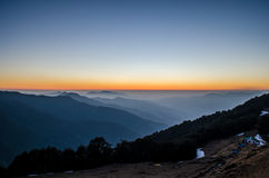 Nag Tibba Base Camp and Surrounding Mountains. After sunset view of nag tibba base camp and surrounding mountains Royalty Free Stock Images