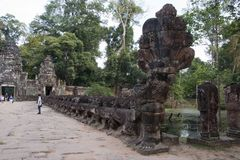 Naga of the balustrade causeway across the moat to west entrance of the 12th century Preah Khan temple stock image
