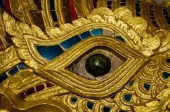 Naga Eye close up. Close up view of the eye of a ceramic Naga snake statue at the front of Wat Phra Singh temple, Chiang Mai, Thailand Stock Images