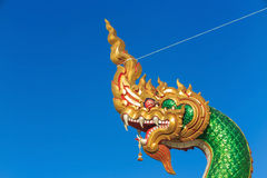 The naga head guarding The temple. In Bangkok Thailand, blue sky background Stock Image