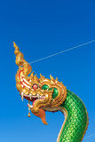The naga head guarding The temple. In Bangkok Thailand, blue sky background Royalty Free Stock Image
