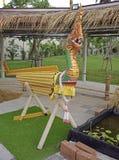 Naga head with wooden bamboo body Royalty Free Stock Photography