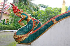 Naga ladder sculpture in Lao temple. Laos Royalty Free Stock Photo