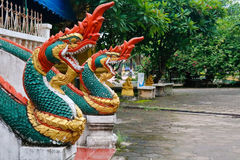 Naga ladder sculpture in Lao temple. Laos Royalty Free Stock Images