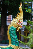 Naga ladder sculpture in Lao temple. Laos Stock Photo