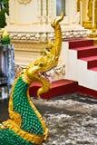 Naga ladder sculpture in Lao temple. Laos Royalty Free Stock Photos