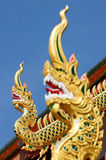 Naga. This is Naka. It is the holy serpent. It beliefs of the people of the east. We can see it on the roof of the temple In Thailand stock photography
