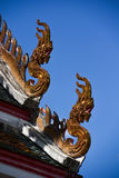 Naga sculpture on the roof temple Royalty Free Stock Image