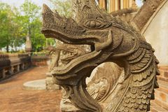 Naga sculpture at the stairs outside of the Hor Phra Keo buddhist temple and  museum in Vientiane, Laos. VIENTIANE, LAOS - APRIL 23, 2012: Naga sculpture at the Royalty Free Stock Photography