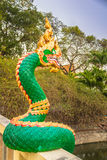 Naga sculpture on the wall. Royalty Free Stock Image
