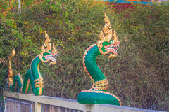 Naga sculpture on the wall. Stock Image