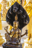 Naga serpent covering the Buddha Stock Photos