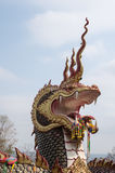 Naga or serpent statue in Wat Tham Pha Keong. Naga or serpent statue in Wat Tham Pha Keong at Wiang Kao District Khonkaen Province Thailand Stock Photo
