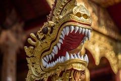 Naga snake statue in a thai tempe stock photo