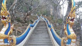 Naga staircase. Leading up the hill. Blue snake scales Snake is semi-divine animals To protect Buddhism There are a lot of power and strength According to Royalty Free Stock Images