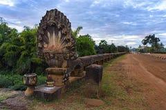 Naga statue on historic Preah Tis Bridge, Cambodia Royalty Free Stock Image