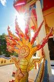 Naga statue infront of Thai style Stock Photos