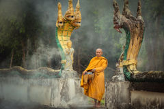 Naga Statue with Monk alms round royalty free stock photo