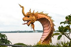 naga statue at river side in public park between Thailand and la Royalty Free Stock Photos