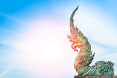 Naga statue spray water to the sea with blue sky background Royalty Free Stock Photography