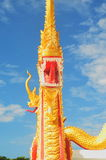Naga statue in Thai temple, blue background Stock Photos