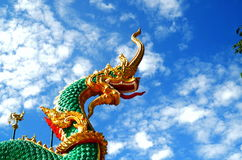 Naga statue in Thai temple, blue background Royalty Free Stock Photo
