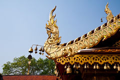Naga statue on thai temple roof Stock Photography