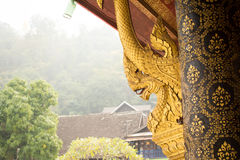 Naga statue in wat mai Stock Photo
