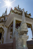 Naga statue with White pagoda in thai temple Royalty Free Stock Images