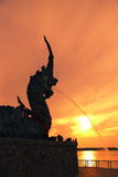 Naga statues spraying water Songkhla Attractions. Light golden sunset Statue Nagas royalty free stock images