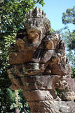 Naga stone statue in front of famous Angkor Wat temple Royalty Free Stock Photo