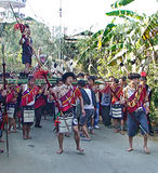 The naga warrior. A ao naga ceremonial dance depicting village folks honouring the great warrior on his return after killing a tiger. this picture was taken on royalty free stock photo