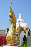 Naga with white buddha. Naga in front of white buddha Royalty Free Stock Image