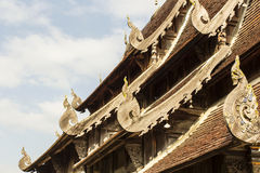 Naga wood carving roof tile at Wat Ton Kwain Chiangmai, Thailand Royalty Free Stock Image