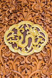 Naga wood Carving Wall sculptures in thai temple Stock Images